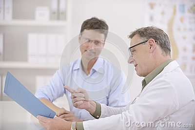 Doctor showing results to  patient