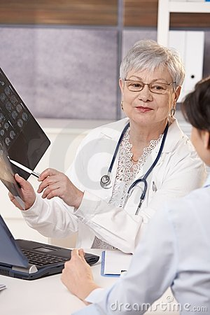 Doctor showing scan results to patient