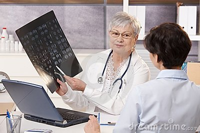 Doctor showing x-ray results to patient