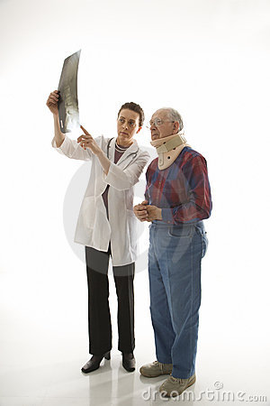 Doctor showing x-ray to elderly man in neck brace.