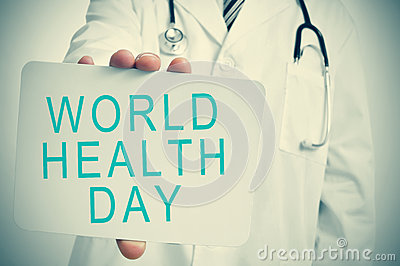 Doctor shows a signboard with the text world health day Stock Photo