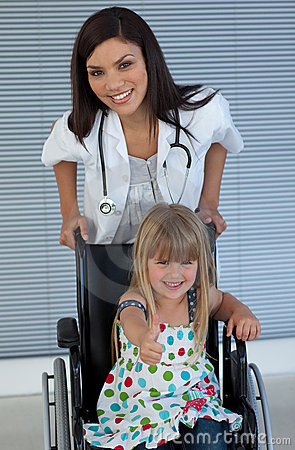 Doctor and Smiling girl on a wheelchair