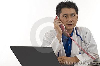 Doctor speaking with patient on the telephone