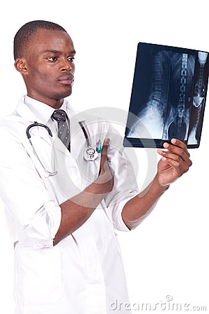 Doctor standing and analysing a radiography
