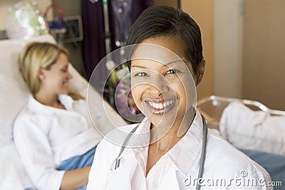 Doctor Standing In Her Patients Room