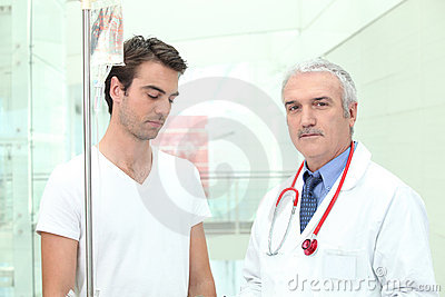 Doctor standing with a patient