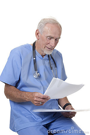 Doctor studying patient s records