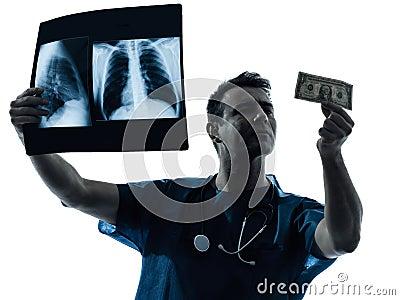 Doctor surgeon man examing dollar bill silhouette