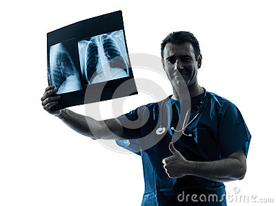 Doctor surgeon radiologist examining lung torso  x-ray image thu