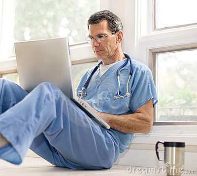 Free Doctor Takes A Coffee Break Stock Photography - 4447002