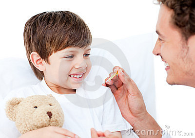 A doctor taking little boy s temperature