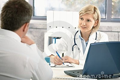 Doctor taking notes about patient