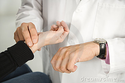 Doctor taking patient s pulse.