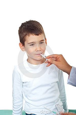 Doctor taking temperature to a child