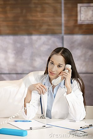 Doctor talking on phone in office