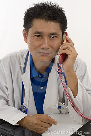 Doctor talking to patient on the telephone
