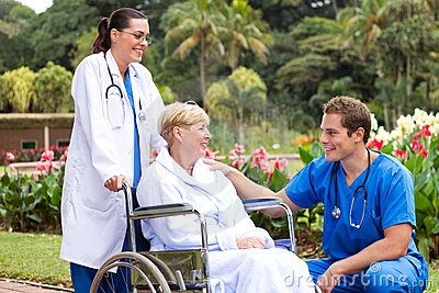 Doctor talking to recovering patient