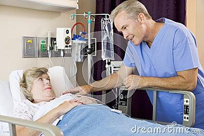 Doctor Talking To Senior Woman