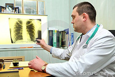 Doctor throwing a look to a chest x-ray image
