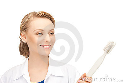 Doctor with toothbrush