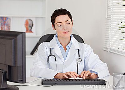 Doctor typing with her computer