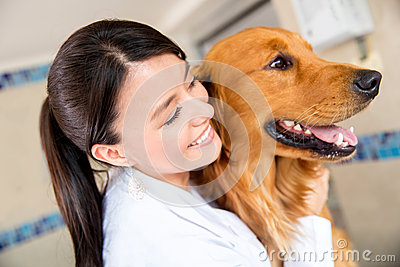 Doctor hugging a dog