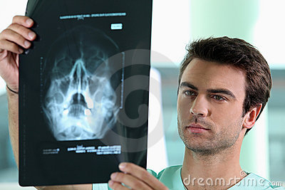 Doctor watching X-ray