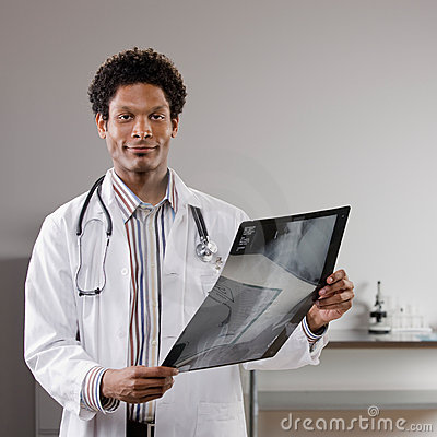 Doctor wearing lab coat examining medical x-ray