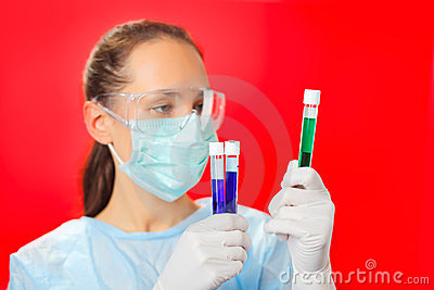 Doctor (woman) analyzing medical test tubes