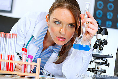 Doctor woman analyzing results of medical test