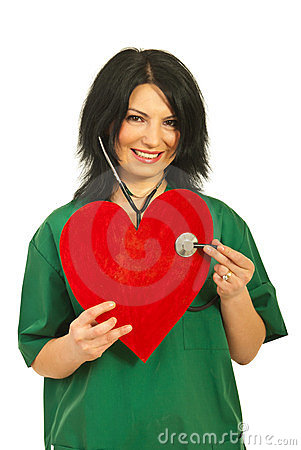 Doctor woman examine heart shape