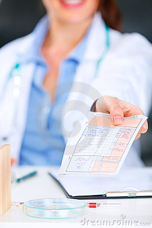Doctor woman giving medical prescription. Closeup.