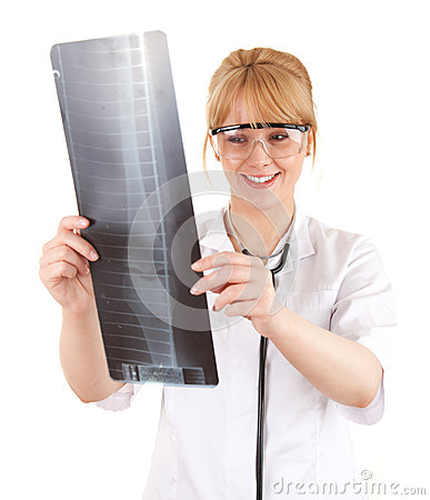 Doctor woman in looking at x-ray