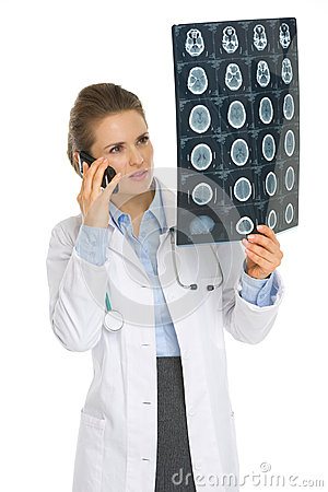 Doctor woman speaking phone and looking on MRI