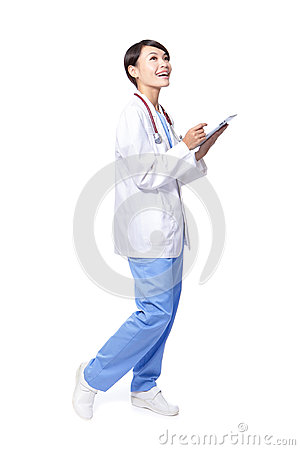 Doctor woman using pc in full length