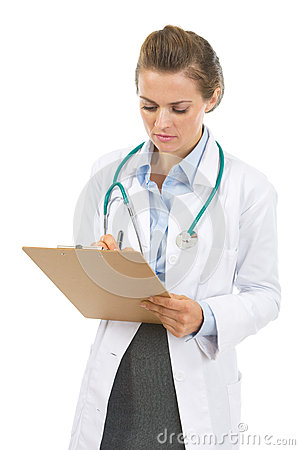 Doctor woman writing in clipboard