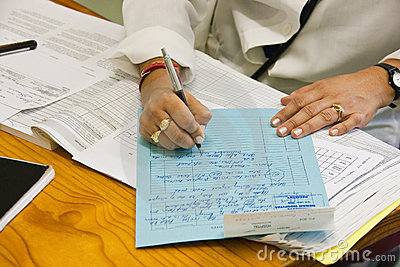 Doctor writing file