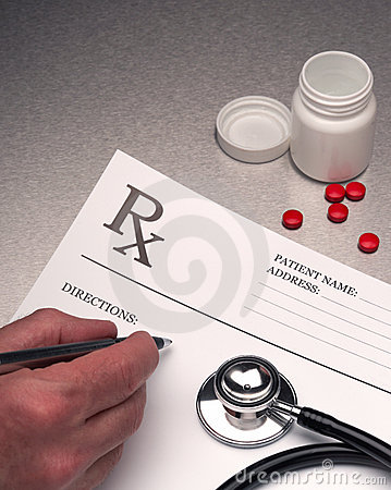 Free Doctor Writing Out RX Prescription Royalty Free Stock Photography - 9822787