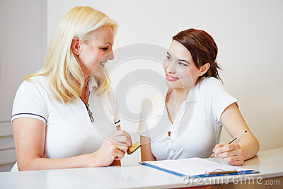 Doctors assistant and dentist at reception