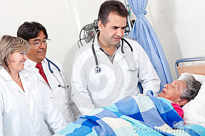 Doctors checking on a patient