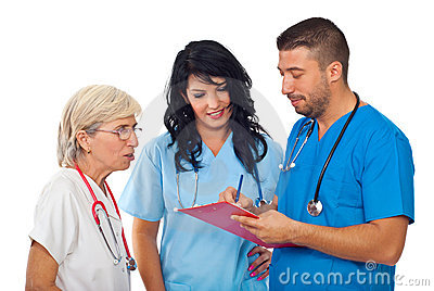 Doctors with clipboard  having conversation