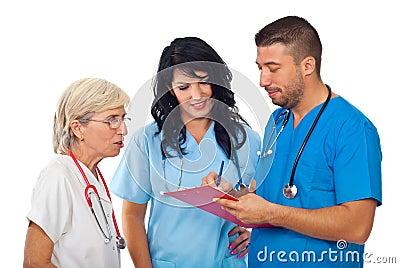 Doctors with clipboard  having conversation