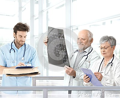 Doctors discussing diagnosis in hospital lobby