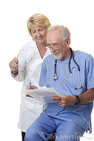 Doctors Discussing Patient's Notes Royalty Free Stock Photo - Image: 10837955