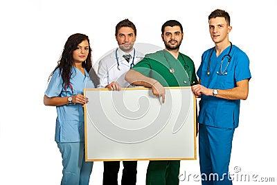 Doctors holding blank board