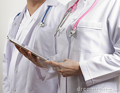 Doctors holding tablet pc