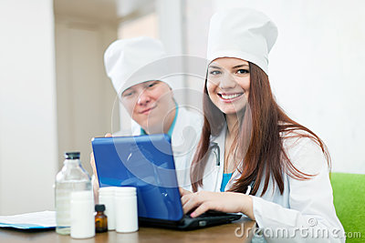 Doctors with laptop in clinic