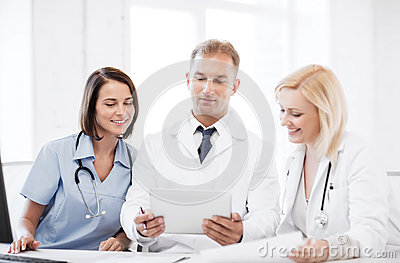 Doctors looking at tablet pc