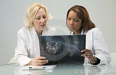 Doctors looking at x ray
