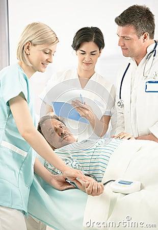 Doctors and nurse examining patient